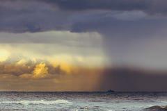 Beginning of the storm rain in ocean, dark cloudy sky Stock Images