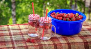Summer refreshing drink homemade lemonade with strawberries in glasses with a straw stock photos