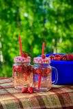 Summer refreshing drink homemade lemonade with strawberries in glasses with a straw stock photo