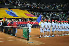 Beginning of a tennis match. Crowd singing national anthem Stock Photography