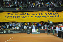 Beginning of a tennis match. Crowd singing national anthem Royalty Free Stock Images