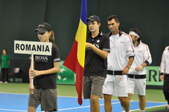 The beginning of the tennis match, Romania enter in the playground Royalty Free Stock Images