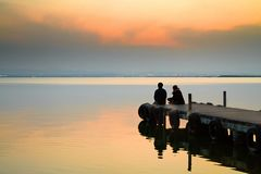 Beginning in Valencia. Sunset in the valencia lagoon. Two young people are witnessing the sunset Royalty Free Stock Photography