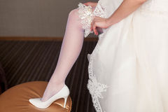 Beginning of the wedding day. the bride wears a wedding garter Stock Images