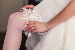 Beginning of the wedding day. the bride wears a wedding garter Stock Photography