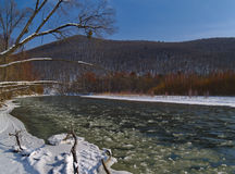 The beginning of winter and ice floating on river Stock Image