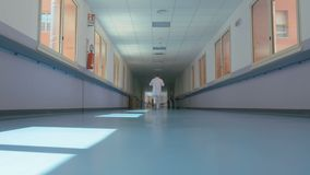 A doctor walking down the hospital corridor.