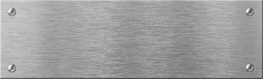 Begränsa stålmetallplattan med nitar Arkivfoto