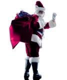 Begrüßungsschattenbild Weihnachtsmanns lokalisiert Stockbilder