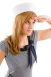 Begrüssenmarineausstattung der jungen Marinefrau Stockfoto