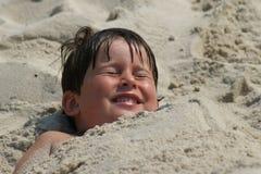 Begraben im Sand Stockfotografie