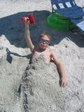 Begraben im Sand Lizenzfreies Stockfoto