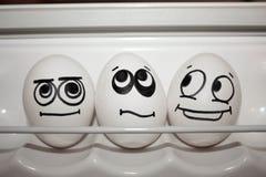 Begrepp av avund tre Roliga ägg tillsammans Royaltyfria Bilder