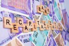 Begrepp av bankrecapitalization på indiska valutaanmärkningar royaltyfria bilder