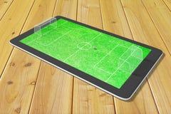 Begrepp av dataspelar i fotboll på den digitala minnestavlan Fotografering för Bildbyråer