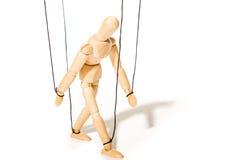 Begrepp av den kontrollerade marionetten Arkivbild