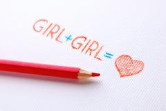 Begrepp av lesbiska kvinnan Blyertspennan drog flickan plus flicka är förälskelse, hjärta arkivfoto