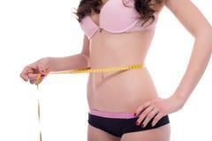 Begrepp av viktförlust flicka henne mätande midja Arkivbilder
