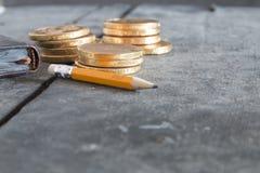 Begrepp för affärsplan Blyertspenna med text och mynt Royaltyfria Foton