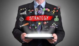 Begrepp för affärsstrategi som visas ovanför en minnestavla Royaltyfri Foto