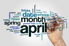 Begrepp för April ordmoln på grå bakgrund Royaltyfri Bild