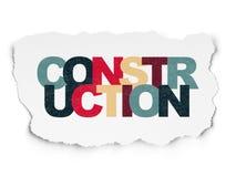 Begrepp för byggnadskonstruktion: Konstruktion på sönderriven pappers- bakgrund Fotografering för Bildbyråer