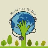 Begrepp för dag för världshälsa med den mänskliga handen, jordklotet och stetoskopet Fotografering för Bildbyråer