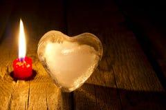 Begrepp för dag för valentin s för för ishjärta och stearinljus abstrakt Royaltyfri Bild