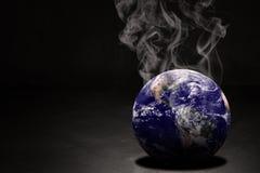 Begrepp för GLOBAL VÄRME och förorening Arkivbild