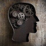 Begrepp för hjärnarbete: kugghjul och kuggar från gammal metall arkivbild