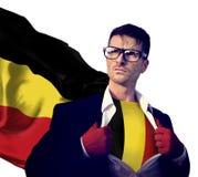 Begrepp för makt för kultur för affärsmanSuperhero Country Belgium flagga royaltyfri foto