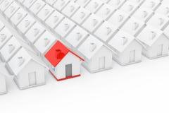 Begrepp för Real Estate egenskapsbransch Rött hus in bland vit Fotografering för Bildbyråer