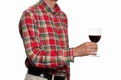 Begrepp för rostat bröd för vinexponeringsglas: man stigning upp ett exponeringsglas av rött vin som isoleras på vit bakgrund med royaltyfria foton