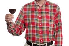 Begrepp för rostat bröd för vinexponeringsglas: man stigning upp ett exponeringsglas av rött vin som isoleras på vit bakgrund med royaltyfri bild