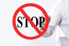 Begrepp för stopp för tecken för affärsmanhandhandstil Arkivbilder