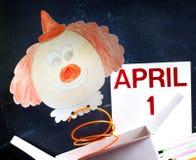 Begrepp för symbol för dag för April dumbommar med clownen Arkivbild