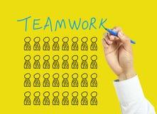 Begrepp för teamwork för affärsmanhandteckning royaltyfri fotografi