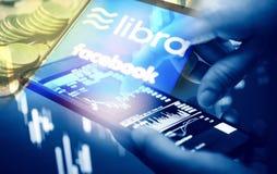 Begrepp för Vågmyntblockchain - den nya projektlibraen en cryptocurrency som lanseras av den Facebook materielgrafen, kartlägger  royaltyfri illustrationer