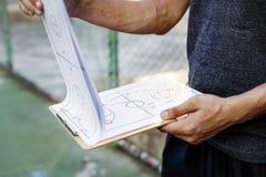 Begrepp för taktik för spelplan för sport för basketspelare Arkivfoton
