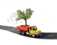 Begrepp lastbil med ett pengarträd Royaltyfri Fotografi