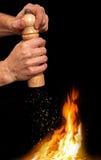 Begrepp med peppar-krukan och extra varma kryddor som glänsande gnistor Fotografering för Bildbyråer