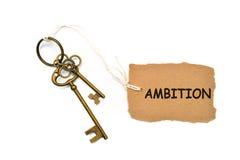 Begreppet av 'ambition' översätts av tangenten och silver nyckel- ch Royaltyfri Fotografi