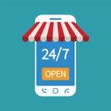 Begreppet av dygnet shoppar direktanslutet på modernt ilar telefonen Arkivfoton