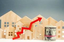 Begreppet av fastighetmarknadstillväxt Förhöjningen i huspriser Stigande priser för hjälpmedel Ökande intresse in arkivbild