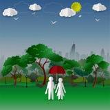 Begreppet av par i staden parkerar med stadbyggnadsbakgrund Arkivbilder