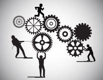 Begreppet av teamwork, byggande kugghjulhjul för folk, detta föreställer också affärspartnerskap, enhet, lagarbete Arkivbild