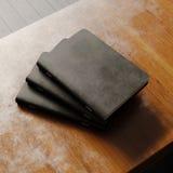 Begreppet av tom anteckningsbok tre med svart texturerade den pappers- räkningen på träskrivbordet Tom horisontalmodell framföran Royaltyfri Bild