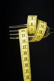 begreppet bantar den metalliska gaffeln Royaltyfria Foton
