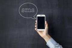 begreppet för bakgrund 3d isolerade vita framförda sms Royaltyfria Foton