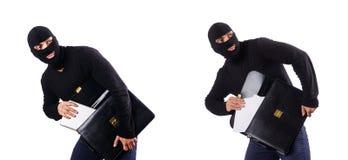Begreppet för industriellt spionage med personen i balaclava Royaltyfri Fotografi